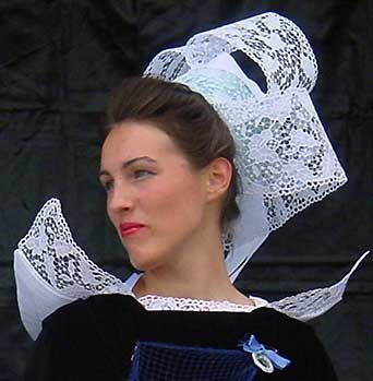 Concarneau, Brittany, France. Each town in Brittany had its own coiffe or hat, worn by girls and women. The variety is amazing, and can still be seen at traditional fairs and fêtes .