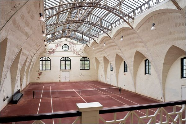 Indoor tennis court - wow! Was the buildling designed for this tennis court or the other way around?