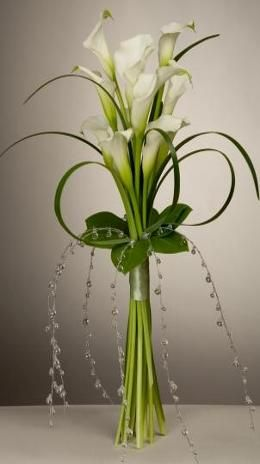 These in Aubergine in a tall glass vase for centrepieces