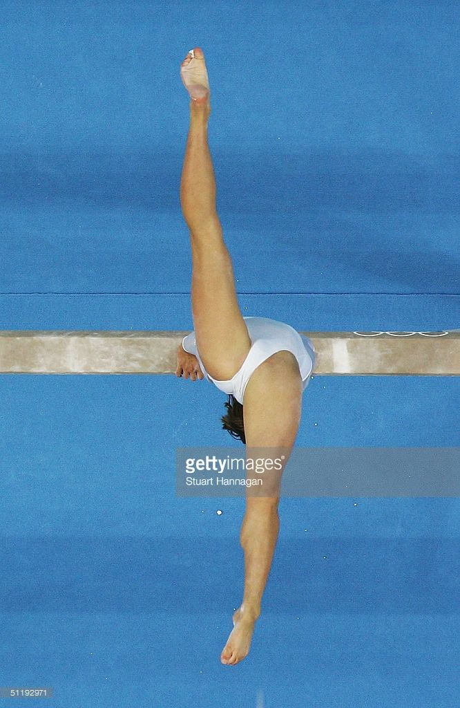 Anna Pavlova of Russia performs on the balance beam during the women's artistic gymnastics individual competition on August 19, 2004 during the Athens 2004 Summer Olympic Games at the Olympic Sports Complex Indoor Hall in Athens, Greece.