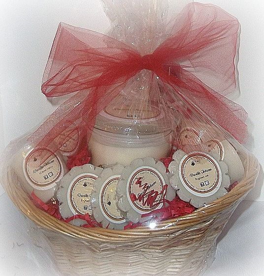 Do you have a candle lover in your life? Gift the gift of fragrance with this gift basket!    This gift basket includes in the fragrance of your choice:    * one 12 oz. candle  * four 15 hour votives  * four candle melt tarts  * 2 oz diffuser oil refill and five reed diffuser sticks  * 4 oz room & linen spray    Your fragrance set will be packaged in a basket, wrapped in shrink wrap, and topped with a beautiful organza bow. Baskets, fill and bow colors may vary.  $48.00