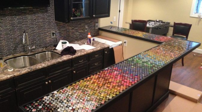 If you've been collecting bottle caps but can't think of a nice project to do with them, maybe this custom bottle cap bar top is the perfect idea for you! It's a DIY project that will definitely make a great conversation piece in your house ;) The custom countertop that you see was made out of five years' worth of bottle caps collectedwith the help of the DIY-er's family and friends. Their initial plan was tolayout images using the bottle caps but insteadopted to create...