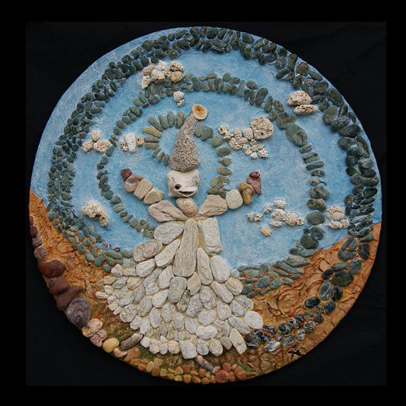 """""""FAT(T)A DI PIETRA"""" (2012)  ARTIST: Cécile Dossogne TECHNIQUE: Manufacture with stones, stucco and seashells on plywood colored with acrylics.  SIZE: Diameter 22.85''. Depth 1.18'' Fairy, circular, natural."""