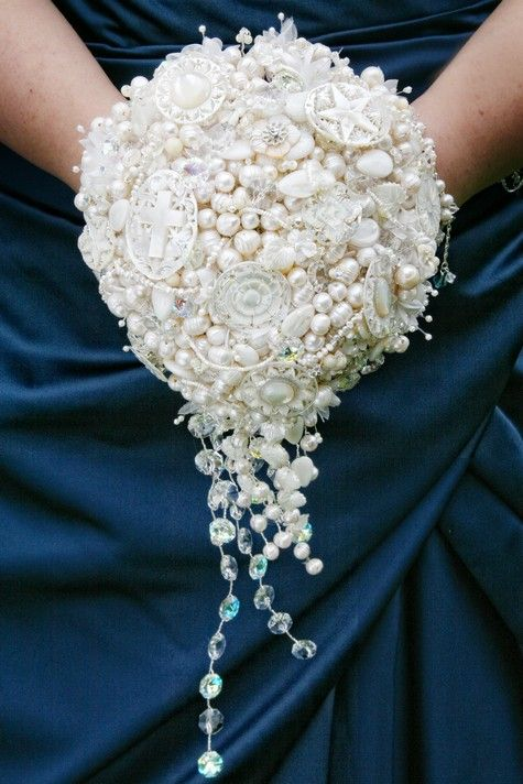 Pearls and cameos are a brilliant idea for non-traditional bridesmaids bouquets, and the bridesmaids will be happy to take them home.
