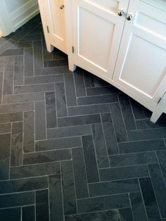 Herringbone tiled floor. Dark dark grey - slate. Modern but also almost industrial looking. Very clean and would look great with stainless steel appliances. #LGLimitlessDesign #Contest