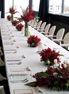 red orchids table arrangement long table wedding flower decoration