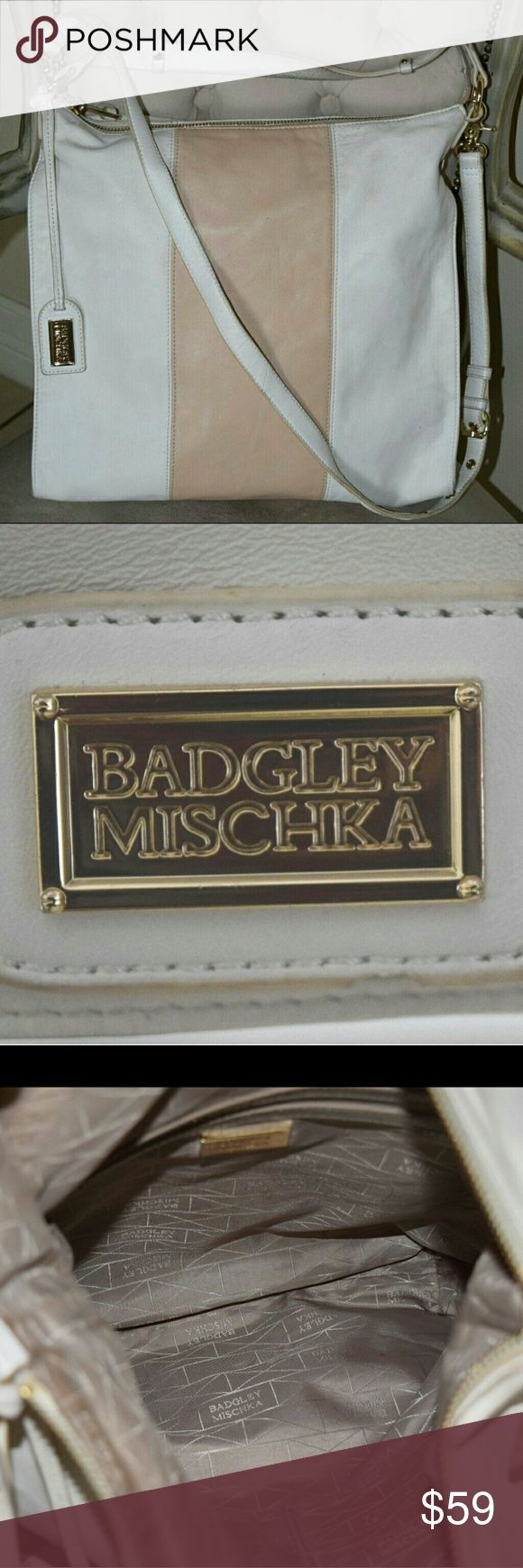 "Classy Badgley Mishka White/Tan Bag, Pre-owned. 15"" Tall x 14 1/2"" wide, 2"" deep.  Pre-owned, Classy White/Tan Leather large slouchy bag Top handle/large strap to use as cross body Gold tone accessory.   *Bag has a few stains and minor scratches -  sign of wear on shoulder strap- please see photos.  Inside of bag has zip pocket and two open pockets.  Zipper closure.  I will be happy to answer any questions.  Thanks for viewing this information. Badgley Mischka Bags Shoulder Bags"