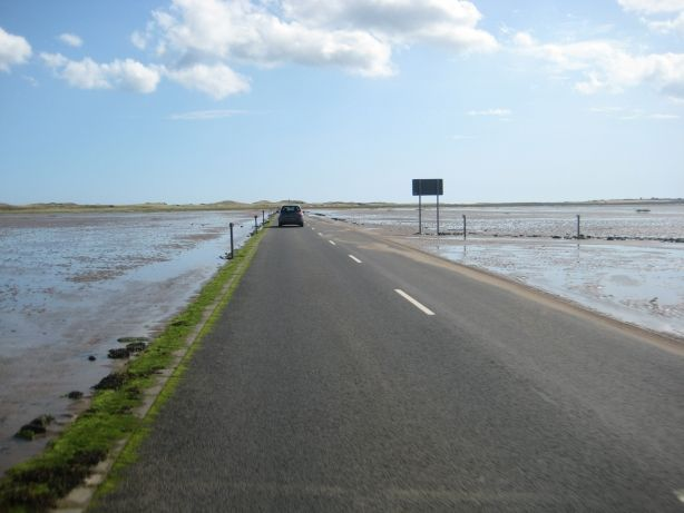Causeway to Holy Island (Lindisfarne), Northumberland, England. Home of the Lindisfarne Gospels. The road is impassable twice daily, when the North Sea covers it.  http://orawww.northumberland.gov.uk/www2/holyisland/holyisland.asp