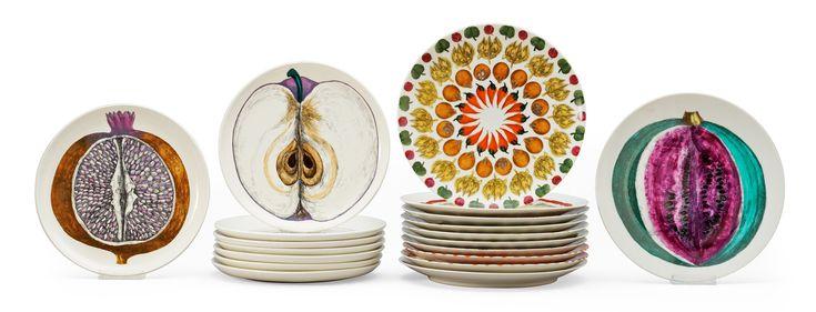 A set of 19 Piero Fornasetti porcelain plates, Milano, Italy.