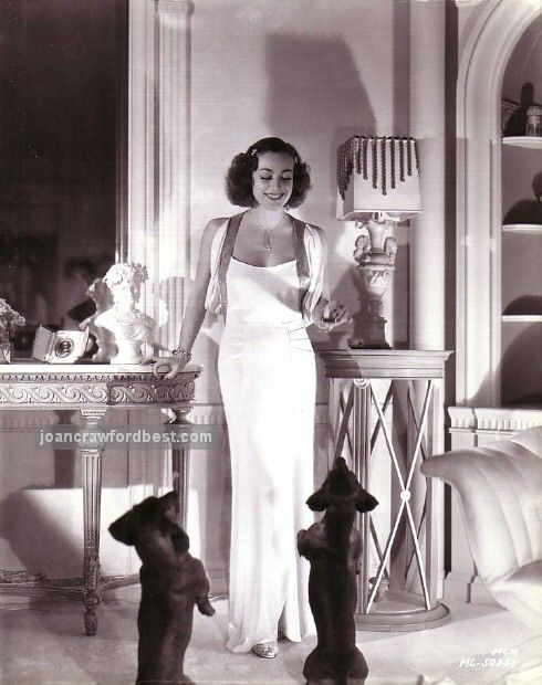 Joan Crawford and her Dachshunds, 1936, at home.