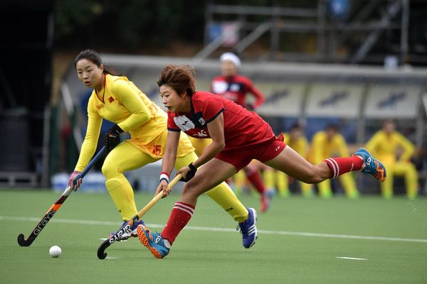 Yang Peng (L) of China and Hyunji Kim (R) of Korea during the FINTRO Women's Hockey World League Semi-Final Pool A game between China and Korea on June 27, 2017 in Brussels, Belgium.