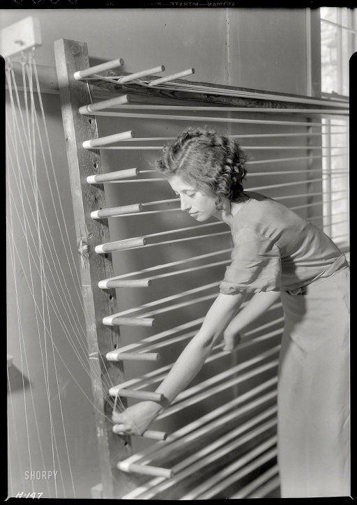 """November 1933. Gatlinburg, Tennessee. """"Beulah Ogle preparing warp for weaving at the Pi Beta Phi School. She is a new weaver at the school and lives on a mountain farm."""""""