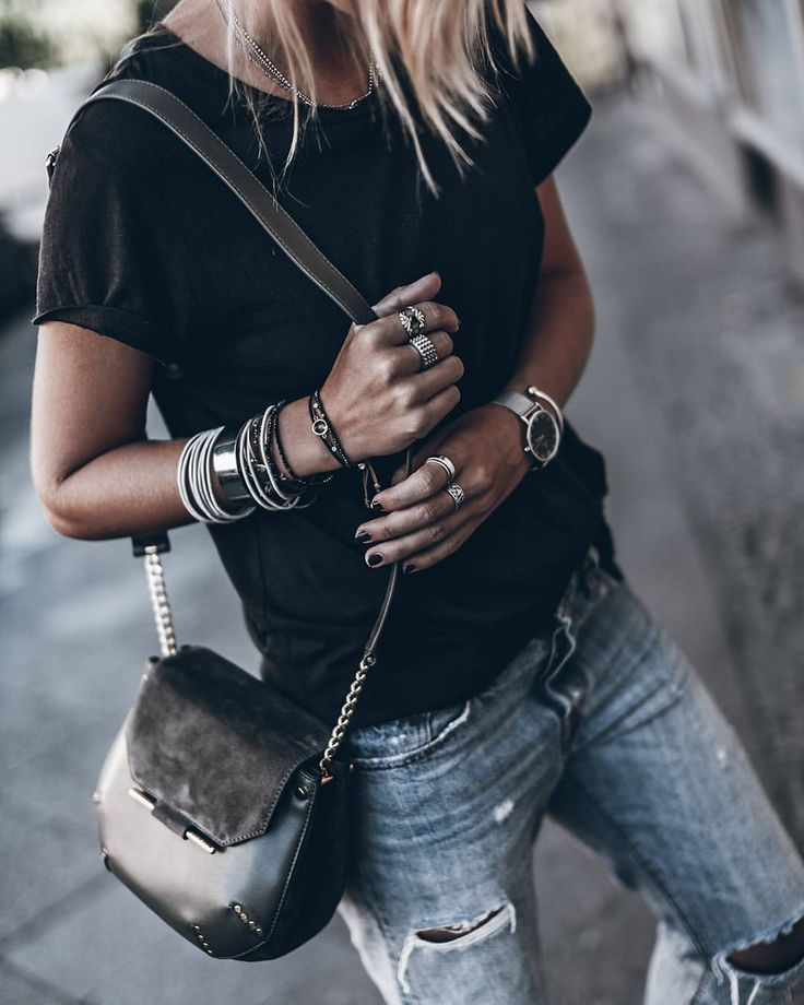 Black tee with silver jewelry.