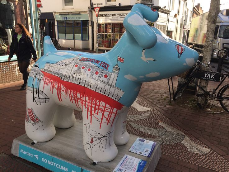 This sculpture is Frank who is inspired by visits to the Brighton seaside. The design wraps well known Brighton architecture and landmarks round the dog in a fluid line drawing.  Location: Gloucester Road Brighton  ~ Snowdogs by the Sea ~