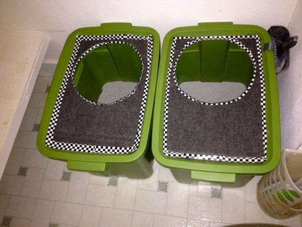 DIY top loading cat litter boxes! I bought two 18-gallon plastic storage containers with lids (about $7.50 each). I decided I liked the idea of using the lid to trap the spare litter crumbs, so I bought 2 feet of grey stair-tread carpet($4) to adhere to the lid with some carpet adhesive double stick tape. My total material cost for TWO boxes was less than $25 — a fraction of any of my store bought options.