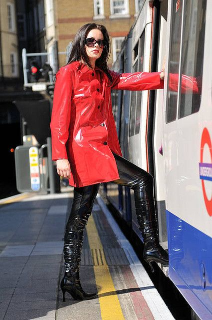 Shiny Pvc Girl Getting On The Train Red Raincoat Pvc