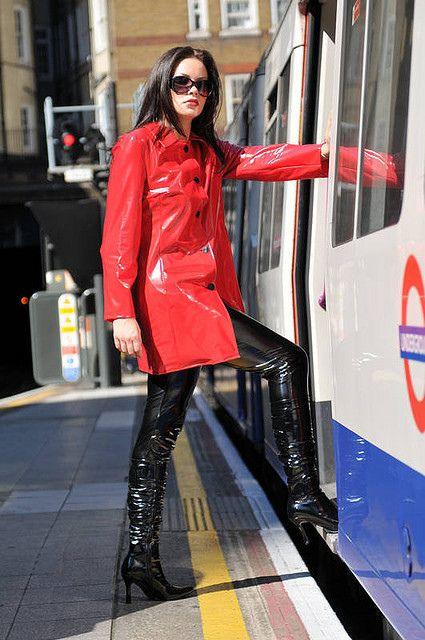 Shiny Pvc Girl Getting On The Train Women In Boots Pvc Raincoat Raincoat Red Raincoat