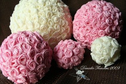 These crepe-paper roses are easy to make and can be used in a lot of different ways. You can put them on a heart shape wreath form and cover them with these roses in the same way you would on these balls. You can also cover a picture frame, or a small special box with them!