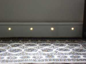 Skirting board with end emitting fibres.