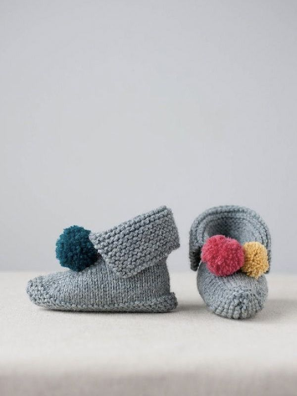 How adorable are these knitted baby booties with a fun pom pom detail? Download the pattern at LoveKnitting
