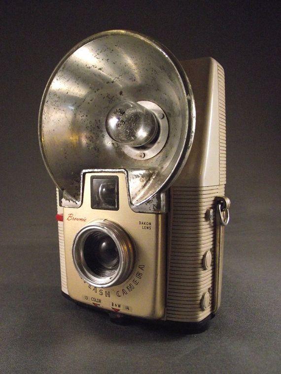 i have this camera, thanks to my grandpa :)  1950's White Kodak Brownie Starflash Camera