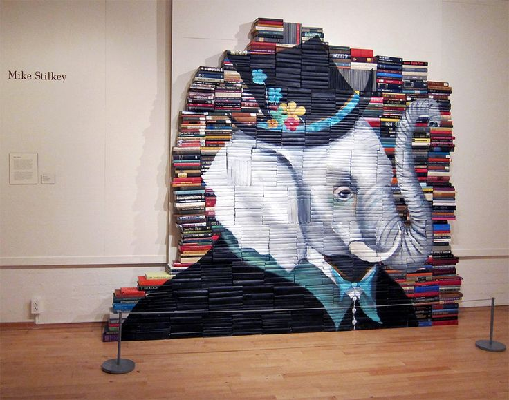 Character Art Painted on Stacks of Books by Mike Stilkey