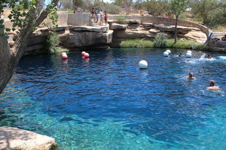 The Blue Hole, Santa Rosa, New Mexico The name is spot on. It's just a giant, 80 ft deep blue hole, but it's a swimming and scuba diving dream come true. And at a year round temperature of 64 degrees, you don't have to wait till summer to wade in these tranquil, cerulean blue waters.  http://www.pagosaspringsluxproperties.com