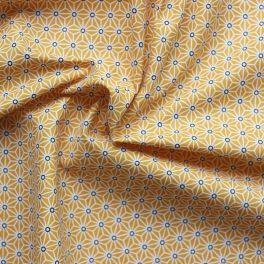 Tissu en coton à motifs origami blanc et noir sur fond jaune moutarde