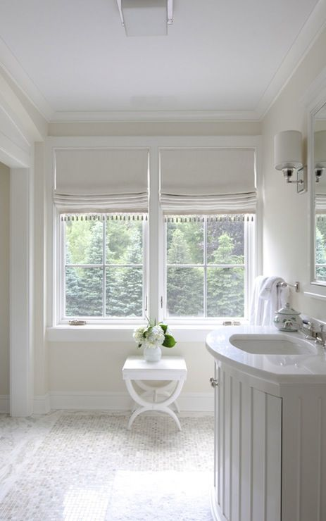Nightingale Design: All white bathroom features glossy white lacquer bow-front bathroom vanity
