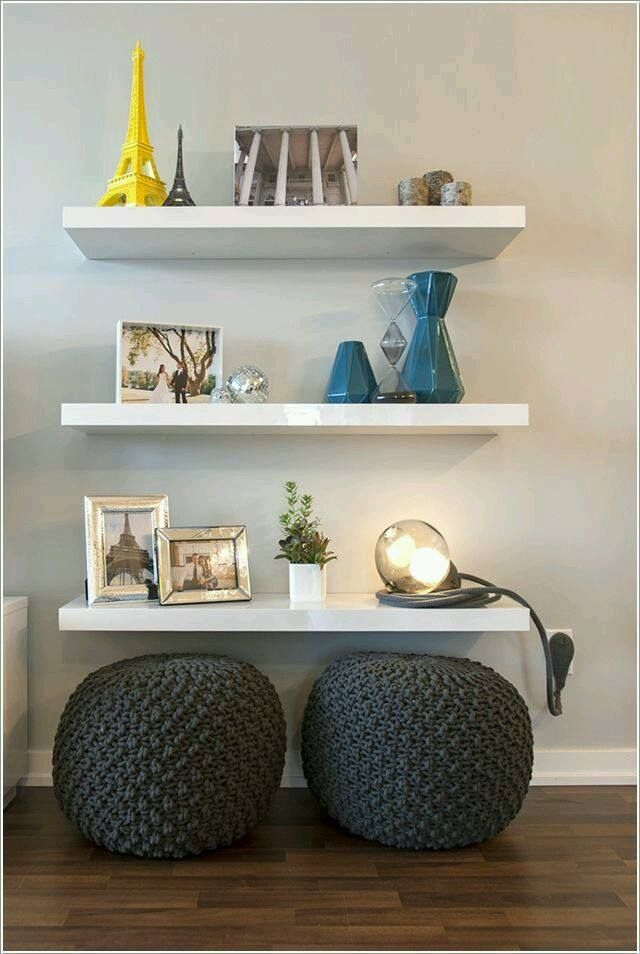 Use The Space Under Floating Shelves And Put Poufs