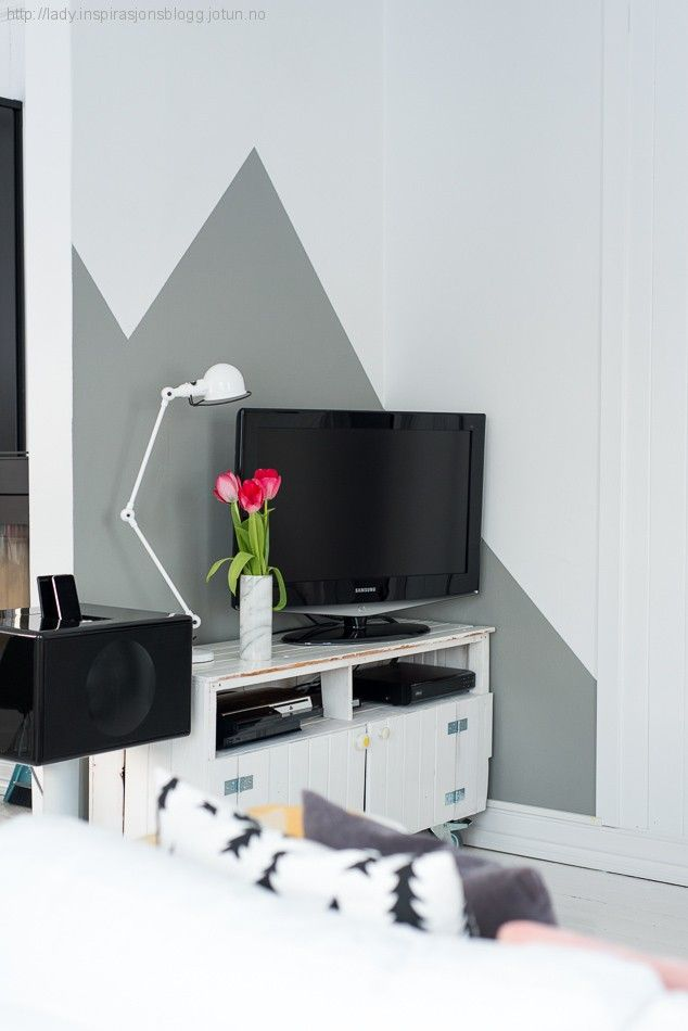 geometric wall behind tv