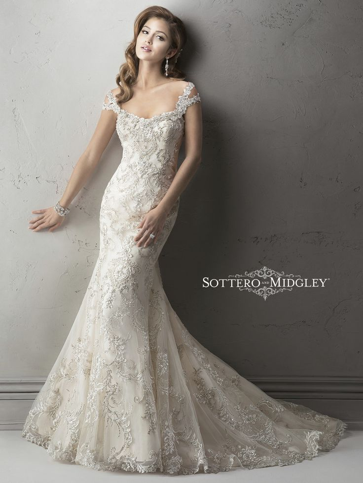 Wedding Dresses, Bridesmaid Dresses, Prom Dresses and Bridal Dresses Sottero & Midgley Wedding Dresses - Style Ettiene 4SC963/4SC963CS [Ettiene] - Sottero & Midgley Haute Couture Wedding Dresses, Fall 2014. Exquisite beaded embroidered lace on tulle drapes over delustered satin in this fit and flare gown featuring dazzling Swarovski crystals on the neckline and shoulder straps. Complete with scoop neckline and finished with crystal button and zipper over inner corset closure.