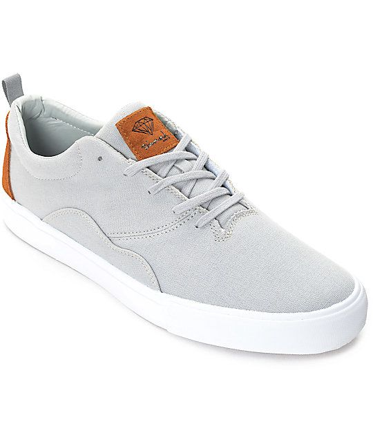 A sleek clean cut shoe, the Diamond Supply Co. Lafayette Grey, Brown and White Skate Shoes are crafted with a grey canvas with brown logo suede embroidery on the tongue and back of heel. Diamond has also given the Lafayette double stitched canvas side pat