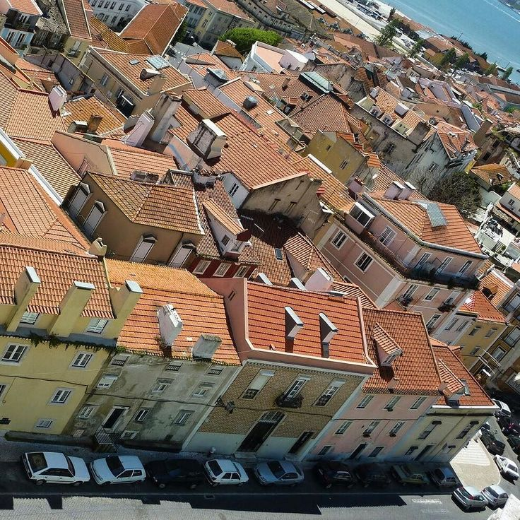 In Alfama Lisbon Portugal. Looking down at my apartment from the Pantheon.  #alfama #lisbon #lisbonportugal #lisbonlovers #lisbonscenes #lisbonlover #europetravel #traveleurope #europe #europeanvacation #europetravels #europetrip #travelblog #travelpics #travelphotos #lisbonstreets