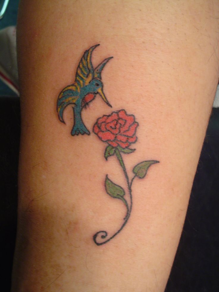 I like the rose but with the hummingbird drawn for Hummingbird hip tattoo