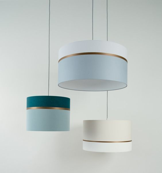 These pendant drum shades are awesome. Loving the golden accent and the color scheme. Seen at de.dawanda.com. Learn how to make a DIY drum shade at www.ilikethatlamp.com  .  .  .  #ilikethatlamp #diylamp #diylamps #diyproject #diyblogger #diyprojects #diyfurn