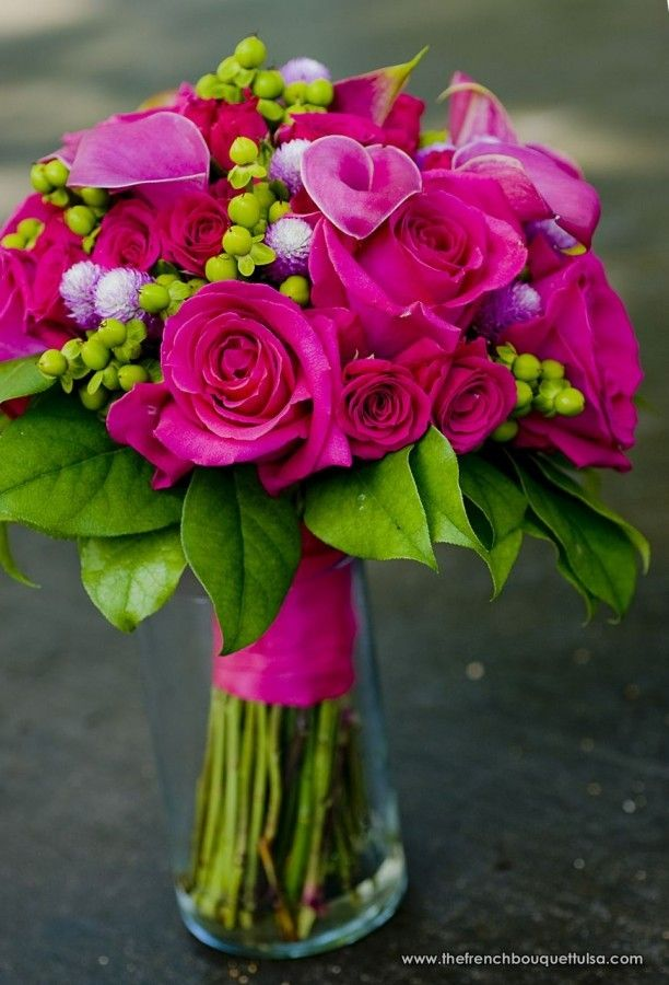 gorgeous bouquet arrangement in shades of hot pink and fuchsia...maybe with the calla lillies purple and green buds are white or little purple blossoms