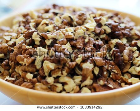 Walnut pieces in a wooden bowl.