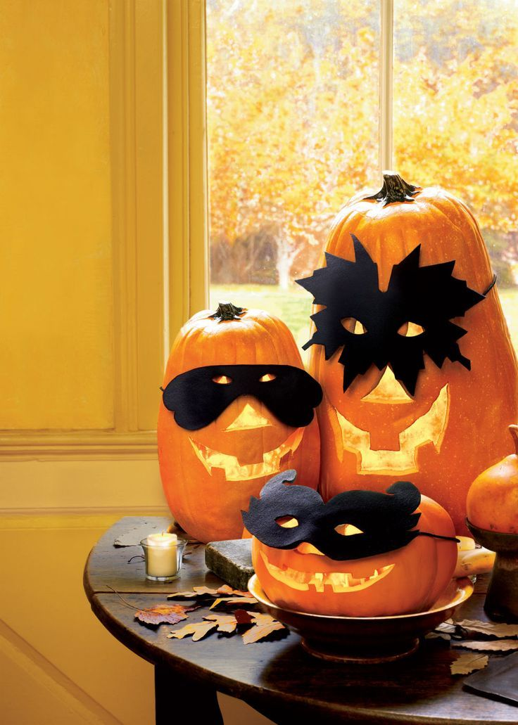 Trick out your jack-o'-lanterns in these bewitching handmade masks. To craft, print out one of our three mask designs, enlarge it to fit your pumpkin, and cut it out. Trace twice onto black felt. Cut out both felt masks and sew together with a basting stitch. Glue to a simple store-bought mask, and replace the elastic string with a black ribbon. Tie mask onto pumpkin.