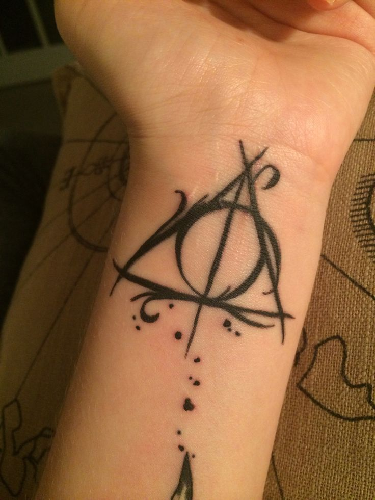 Fancy Harry potter deathly hallows tattoo