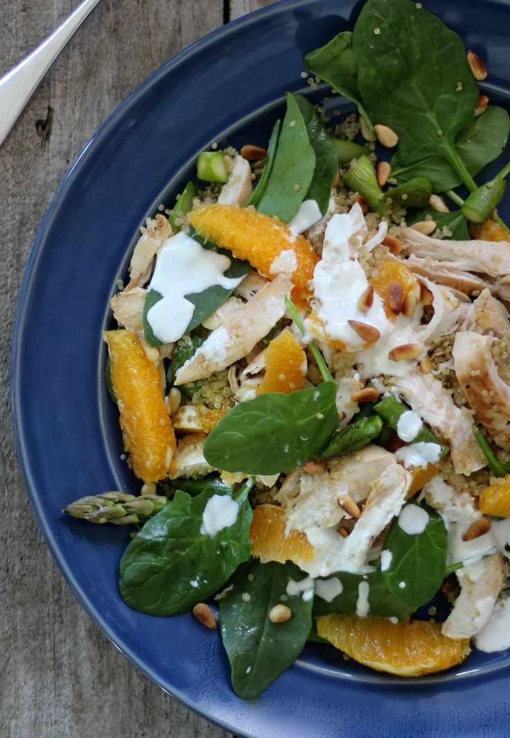 GRILLED LEMON CHICKEN WITH ORANGE, ASPARAGUS AND QUINOA. A protein and vitamin c power kick with season best asparagus and sweet navel oranges topped with a delicious yoghurt dressing. You will love this.   30 Minutes. 573 Calories. Gluten free.