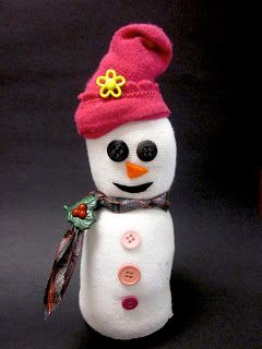 Sock Snowman! SUPPLIES: Infant Socks, Rice, Stuffing, Rubber Bands, & Embellishments:::Create fun and customized snowmen. No sewing required.