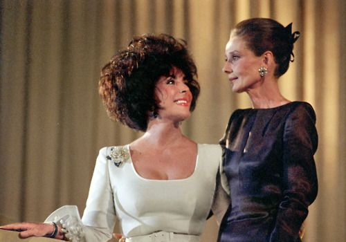 """11 June 1991: Elizabeth Taylor and Audrey Hepburn attend the charity dinner """"Art against AIDS"""" in Basel, Switzerland."""