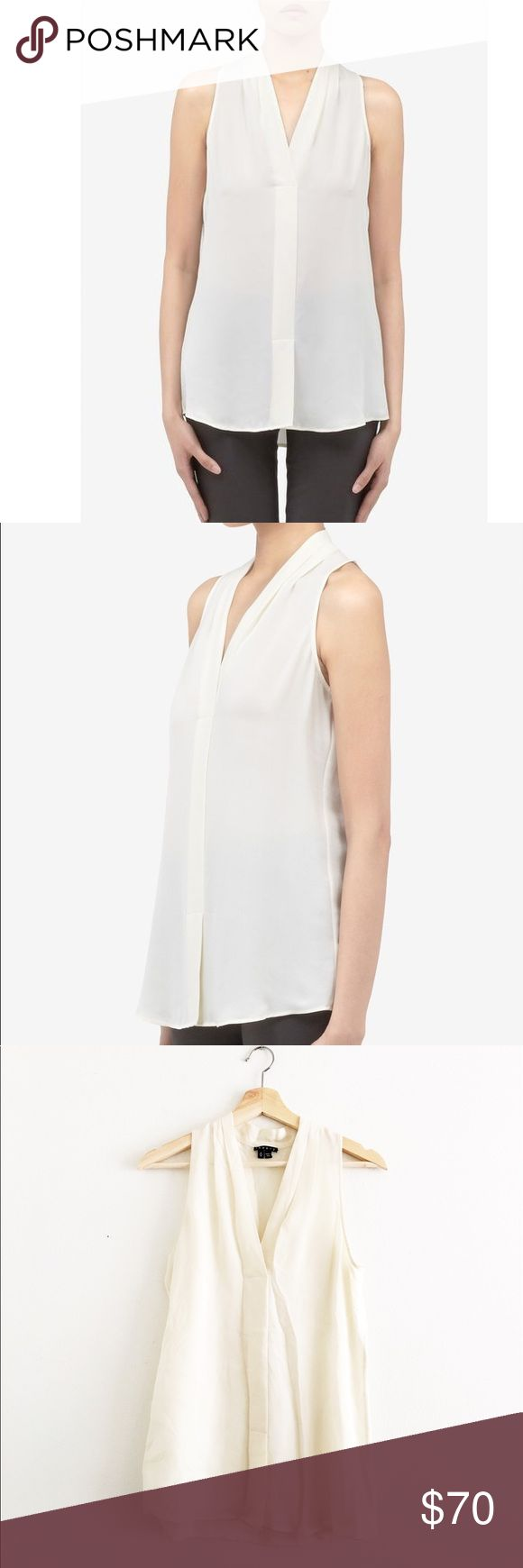 Theory Silk Blouse Super chic cream silk blouse from Theory. The perfect investment for your office wardrobe. You can also pair with a leather skirt for a night look. Faint makeup mark on the back left shoulder area - will come out with dry cleaning. Theory Tops Blouses