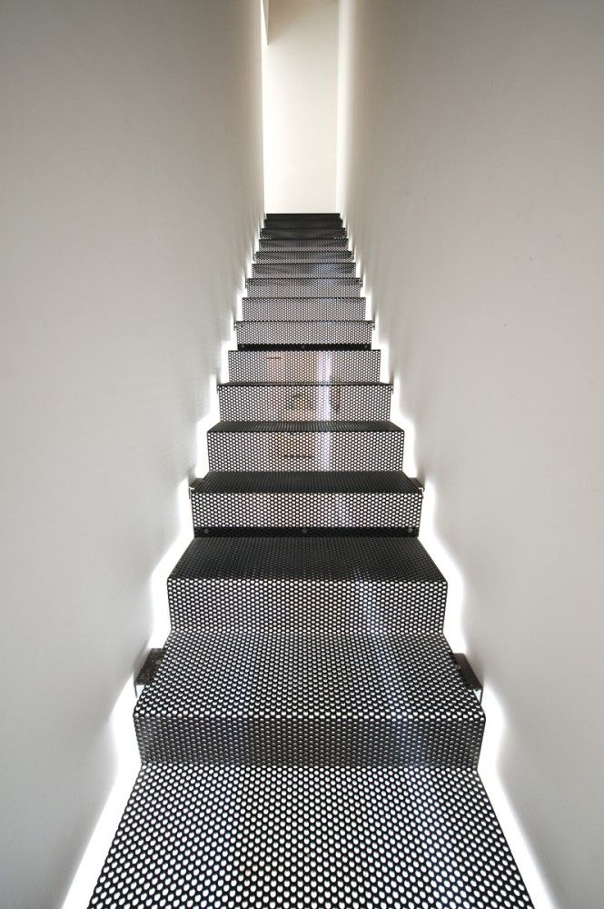 Staircase perforated steps - nice light game.   Helena's Villa / Grech  Vinci Architecture  Design