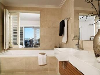 Modern bathroom design with bi-fold windows using ceramic - Bathroom Photo 172051