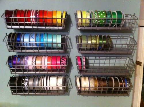 """""""I bought a bunch of the Bygel wire baskets from (where else?) IKEA.  They were only $1.99 so it didn't break the bank!  I removed the wire handle and secured them directly to the wall instead."""" -for J's duct tape collection"""