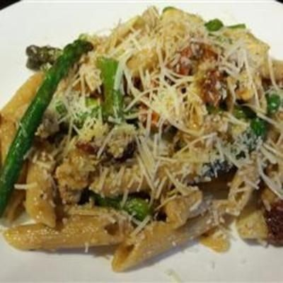 Chicken Penne with Asparagus, Sun-dried Tomatoes, and Artichoke Hearts (I would use whole wheat pasta)
