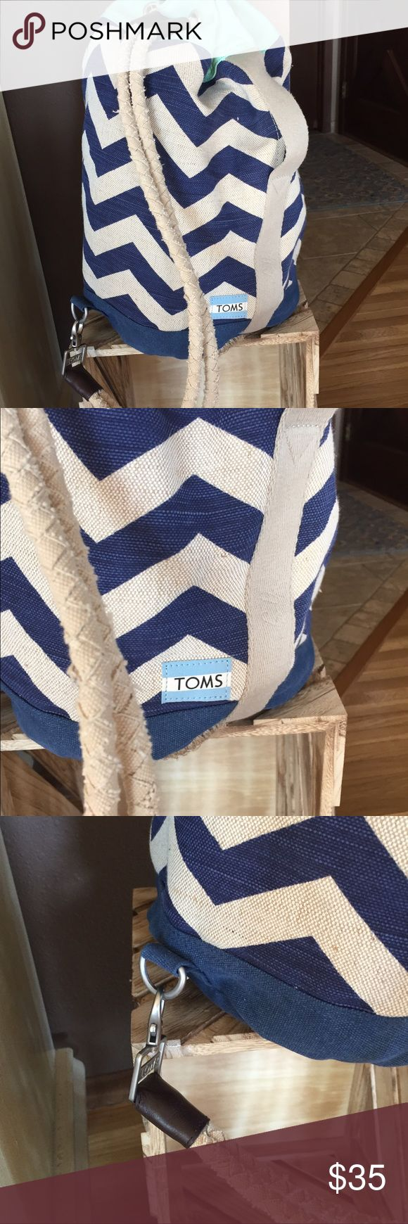 TOMS backpack TOMS backpack...navy and cream chevron striped with light green accents...drawstring straps attached with dog snap on bottom end...inside zip pocket..never used TOMS Bags Backpacks