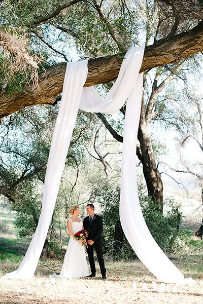 The candid photos of you and your groom exchanging vows are ones you'll treasure forever. With this in mind, don't skimp on altar décor — you'll want to make sure it's unforgettable. Even something as simple as draping gauzy fabric over a tree in an already stunning setting can create a breathtaking effect.Related: 50 Gorgeous Wedding Ceremony Structures